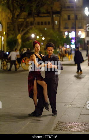 A couple dance in the streets of Sevilla