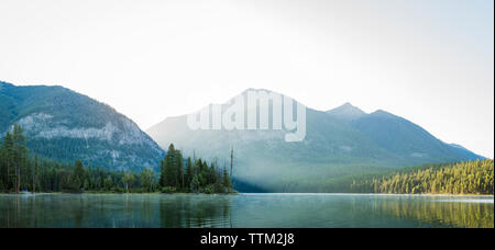 Panoramic view of lake against mountains - Stock Photo