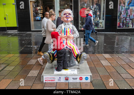 Glasgow, Scotland, UK. 17th June, 2019. Oor Billy, created by Robert Stevenson. This statue is a tribute to Glasgow comedy legend Billy Connolly. It depicts his life from his early days working in the Glasgow shipyards, to his boots from the 1970's and dungarees from the 1980's. His shirt is based on his appearance in 'An audience with...' from 1985. his purple beard and moustache from the early noughties and the purple tined glasses he wears today. The sculpture is part of Oor Wullie's BIG Bucket Trail. Credit: Skully/Alamy Live News - Stock Photo