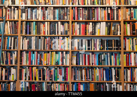 Rows of books inside St Georges secondhand bookshop in Prenzlauer berg, Berlin, Germany - Stock Photo