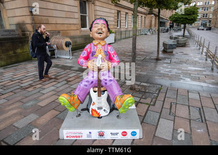 Glasgow, Scotland, UK. 17th June, 2019. Oor Jimi, created by Betti Moretti. The Jimi Hendrix Experience performed in Glasgow twice. Hendrix literally brought the house down with his performance by setting fire to his famous guitar on stage, This statue is in honour of Scotland's rich music history, complete with a replica of his legendary guitar. The sculpture is part of Oor Wullie's BIG Bucket Trail. Credit: Skully/Alamy Live News - Stock Photo