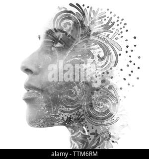 Double exposure. Paintography. Portrait of a beautiful young female model disappearing behind black ink painting on white background - Stock Photo