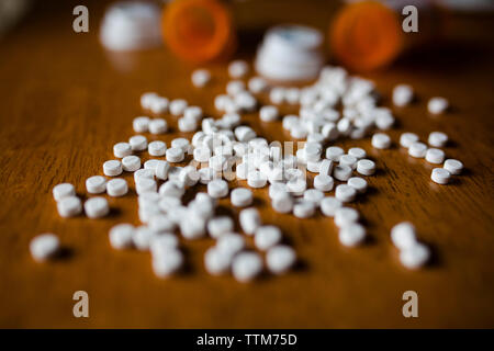 Close-up of pills and bottles on table - Stock Photo