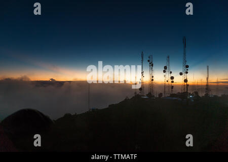Silhouette of Telcom towers at Volcan Baru during sunset - Stock Photo