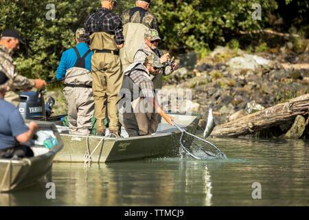 USA, Alaska, Redoubt Bay, Big River Lake, fishermen netting fish at Wolverine Cove - Stock Photo