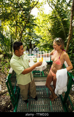 BELIZE, Punta Gorda, Toledo, guests can enjoy cocktails and complimentary snacks at Belcampo Belize Lodge and Jungle Farm - Stock Photo