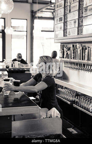 USA, Oregon, Bend, Pacific Pizza and Brew, bartender - Stock Photo