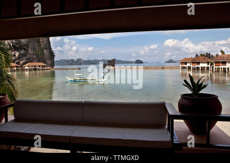 PHILIPPINES, Palawan, El Nido, Lagen Island, cottage room view at Lagen Island Resort, Bacuit Bay in the South China Sea - Stock Photo