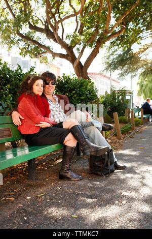 USA, California, San Francisco, a couple from Napa sit and enjoy the afternoon, Washington Square Park - Stock Photo