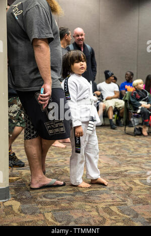 USA, Oahu, Hawaii, portrait of a young boy Jujitsu Martial Arts fighter before the start of the ICON grappling tournament in Honolulu - Stock Photo