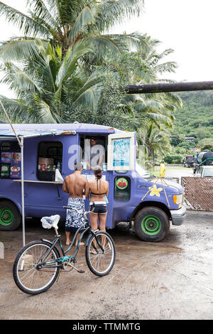 USA, Oahu, Hawaii, portrait of MMA Mixed Martial Arts Ultimate fighter Lowen Tynanes and Logan Garcia buy Acai Bowls at a food truck on the North Shor - Stock Photo