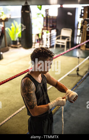 USA, Oahu, Hawaii, an up and coming boxer prepares his hands for a sparring match in a gym in Honolulu - Stock Photo