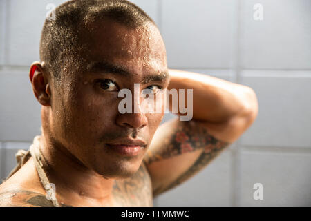 USA, Oahu, Hawaii, portrait of professional boxer Mike Balasi in a Honolulu gym after his training and sparring session - Stock Photo