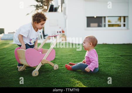 Girls fighting over doll Stock Photo - Alamy