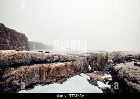 Snow in rocky ravine - Stock Photo
