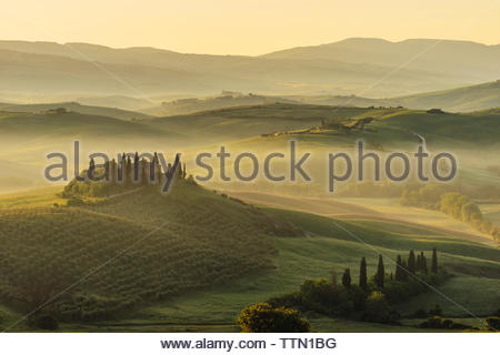 Scenic view of rolling landscape during foggy weather - Stock Photo