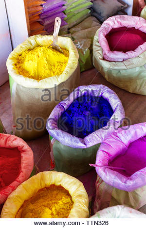 Overhead view of powder colors at market stall - Stock Photo