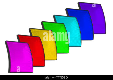 A set of seven LED spotlights of pink, red, blue, yellow, green, turquoise, blue and purple colors on a white background. Diffuser with small cells. - Stock Photo