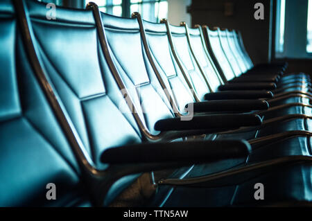 Empty chairs at airport waiting area - Stock Photo
