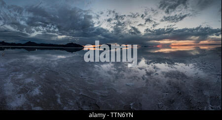 Panoramic view of Bonneville Salt Flats against cloudy sky - Stock Photo