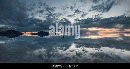 Panoramic view of Bonneville Salt Flats against cloudy sky during dusk - Stock Photo