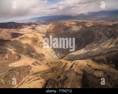 High angle view of Bingham Canyon against cloudy sky - Stock Photo