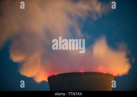 Close-up of smog emitting from smoke stack - Stock Photo