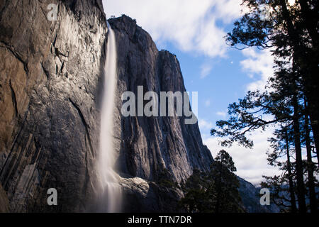Low angle view of waterfall at Yosemite National Park against sky - Stock Photo