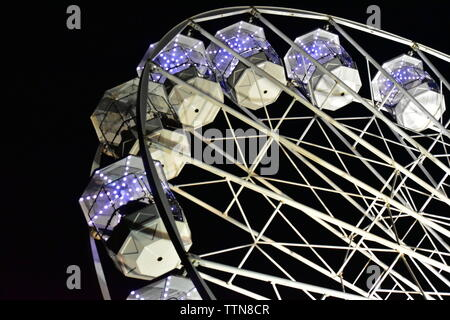 Newport, Isle of Wight - June 16 2019: Isle of Wight Festival Fairground ride, Ferris Wheel at night. - Stock Photo