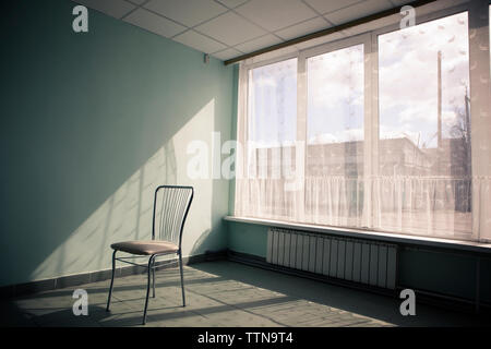 Chair in empty room - Stock Photo