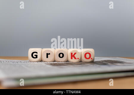 Symbol for the end of the grand coalition called 'GroKO' between the parties SPD and CDU in Germany. Cubes form the abbreviation 'GroKO' placed on a n - Stock Photo