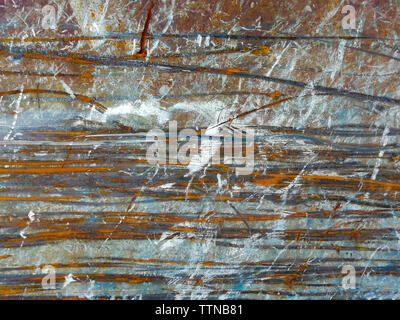 Rusty metal background with rust streaks and white spots. Material worn out by long use. Horizontal texture, copy space. - Stock Photo