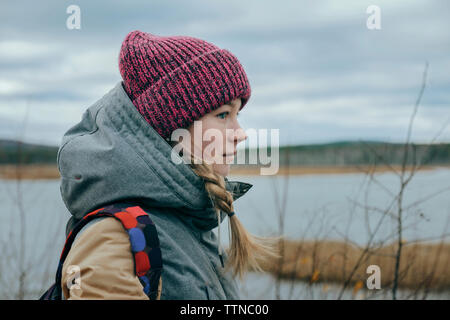 Profile of young woman in autumn