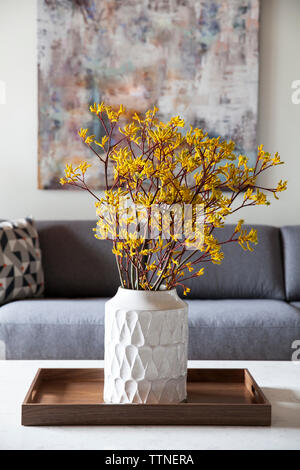 Flowers in vase on table - Stock Photo