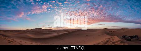 Sunset over Erg Chebbi sand dunes in the desert, Merzouga Morocco - Stock Photo
