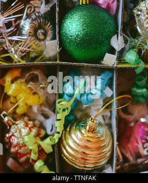 Directly above shot of colorful Christmas decorations in box - Stock Photo