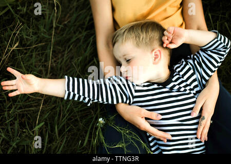 Portrait of a mother and boy lying outdoor. Stock Photo