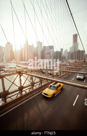 High angle view of car and yellow taxi on Brooklyn Bridge - Stock Photo