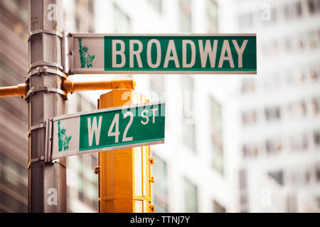 Low angle view of road sign in city - Stock Photo