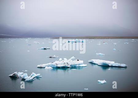 Scenic view of Jokulsarlon against sky - Stock Photo