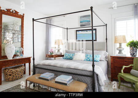 Interior of decorated bedroom in luxury cottage - Stock Photo