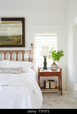Cropped image of bed by side table in luxury bedroom - Stock Photo