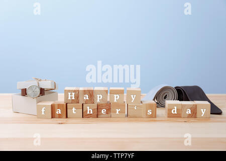 Words on cubes HAPPY FATHER'S DAY and gifts on light background - Stock Photo