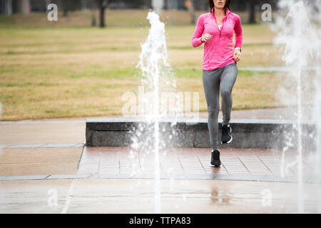 Low section of woman exercising in park - Stock Photo