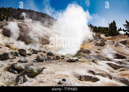 Smoke emitting from mountain at Lassen Volcanic National Park - Stock Photo