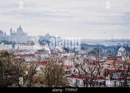 High angle view of cityscape against cloudy sky - Stock Photo