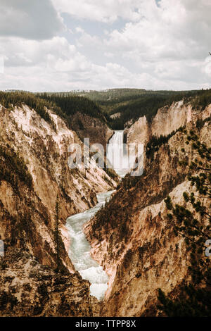 Scenic view Of Yellowstone Falls Against Cloudy Sky In forest - Stock Photo