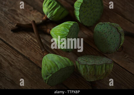 Close-up of fresh lotus pods on wooden table - Stock Photo