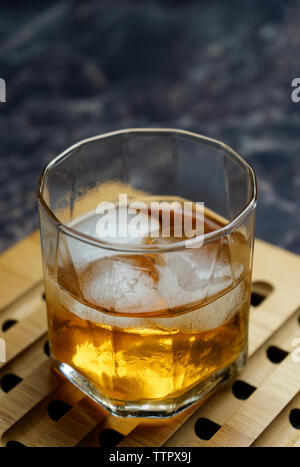 Close-up of ice cubes in alcoholic drink on tray - Stock Photo