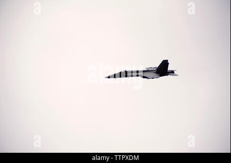 Low angle view of fighter plane flying in clear sky - Stock Photo